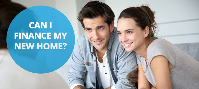 A young couple speak with a mortgage broker at home