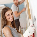 A young couple renovating a house