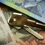 Australian money with house key on top