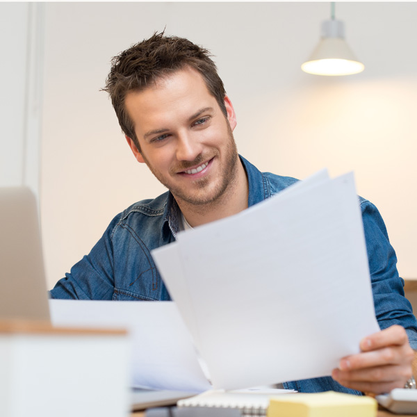 Man smiling looking at documents