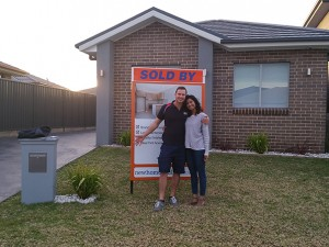 A happy couple who've just bought a home